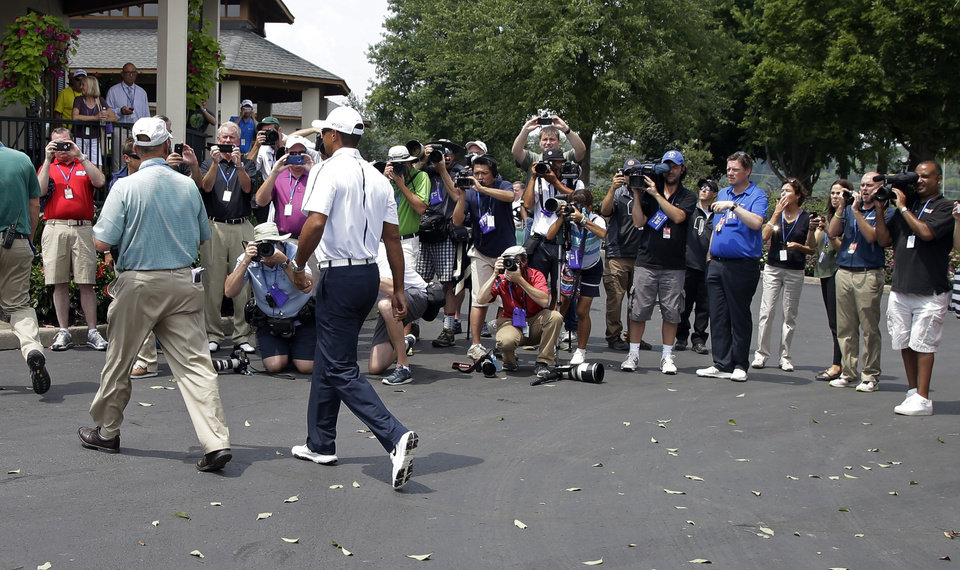 Photo - Tiger Woods arrives for a practice round for the PGA Championship golf tournament at Valhalla Golf Club on Wednesday, Aug. 6, 2014, in Louisville, Ky. The tournament is set to begin on Thursday. (AP Photo/Darron Cummings)