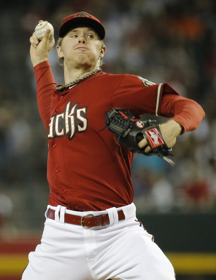 Photo - Arizona Diamondbacks pitcher Chase Anderson throws against the Atlanta Braves during the third inning of a baseball game, Sunday, June 8, 2014, in Phoenix. (AP Photo/Matt York)