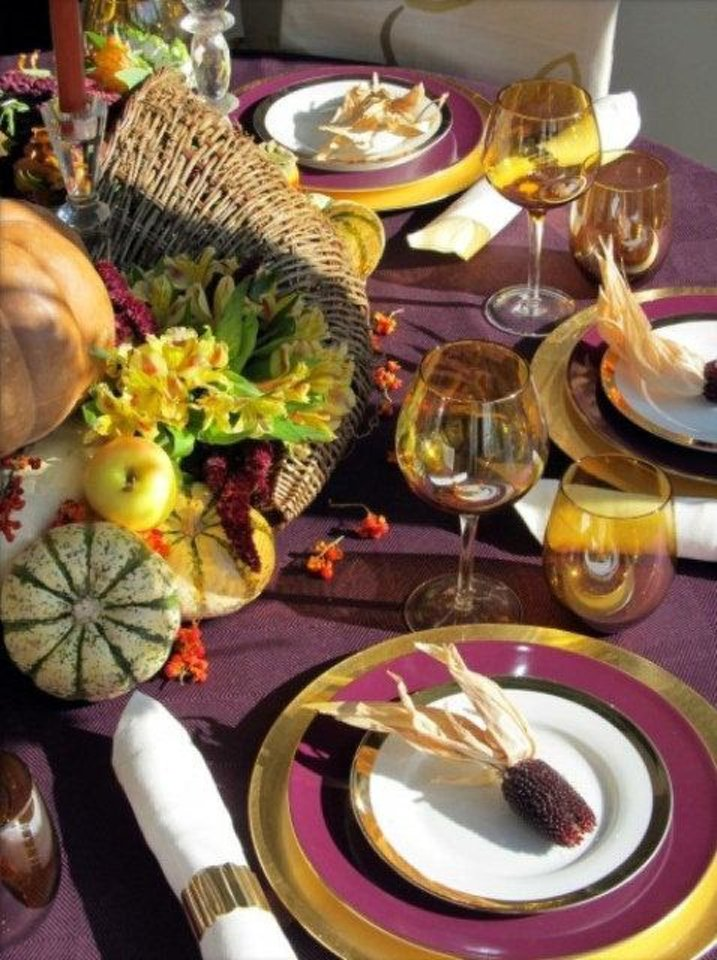 Photo - Holiday trends this year are all about colors -- and not the traditional colors you're used to seeing. Instead of the traditional browns, oranges and golden hues of Thanksgiving decor, mix it up with deep, rich shades of purple mixed with pops of bright yellow, mixed with various colors of gourds. Photo from digsdigs.com.