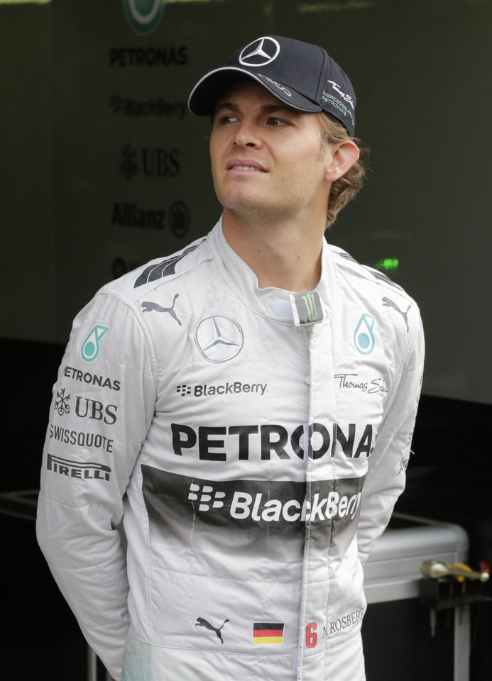Photo - Mercedes driver Nico Rosberg of Germany checks the weather situation outside the pit box, during the third practice session, ahead of Sunday's Belgian Formula One Grand Prix in Spa-Francorchamps, Belgium, Saturday, Aug. 23, 2014. (AP Photo/Yves Logghe)
