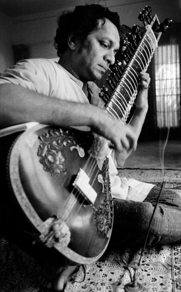 Photo - FILE - In this 1967 file photo, Ravi Shankar plays his sitar in Los Angeles. Shankar, the sitar virtuoso who became a hippie musical icon of the 1960s after hobnobbing with the Beatles and who introduced traditional Indian ragas to Western audiences over an eight-decade career, died Tuesday, Dec. 11, 2012. He was 92. (AP Photo, File)