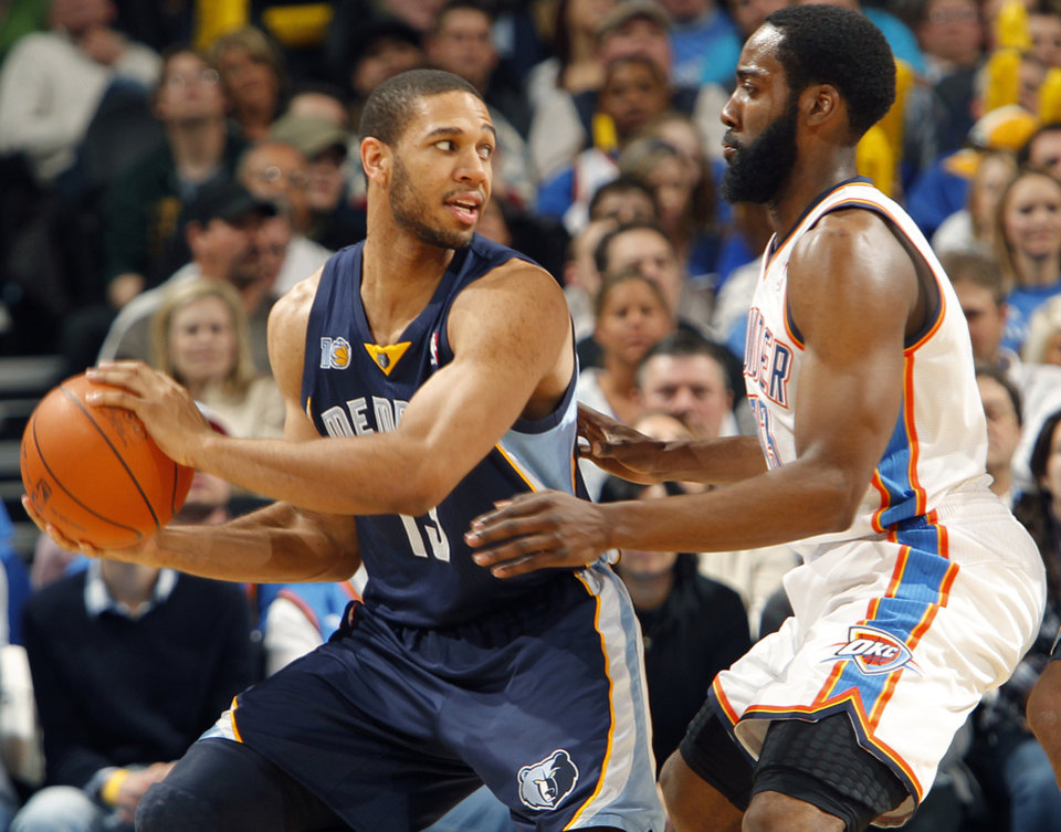 Memphis' Xavier Henry (13) looks for a passing lane past the Thunder's James Harden (13) during the NBA basketball game between the Oklahoma City Thunder and the Memphis Grizzlies at the Oklahoma City Arena on Tuesday, Feb. 8, 2011, Oklahoma City, Okla.