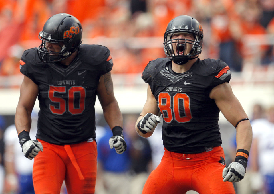 CELEBRATION: Oklahoma State's Jamie Blatnick (50) and Cooper Bassett (80) celebrate a play during the first half of the college football game between the Oklahoma State University Cowboys (OSU) and the University of Kansas Jayhawks (KU) at Boone Pickens Stadium in Stillwater, Okla., Saturday, Oct. 8, 2011. Photo by Sarah Phipps, The Oklahoman    ORG XMIT: KOD