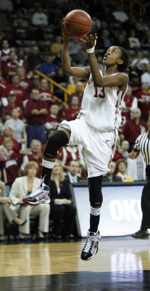 Photo - Danielle Robinson scores on a fast break in the second half as the University of Oklahoma (OU) plays Georgia Tech in round two of the 2009 NCAA Division I Women's Basketball Tournament at Carver-Hawkeye Arena at the University of Iowa in Iowa City, IA on Tuesday, March 24, 2009. 