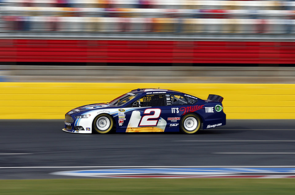 Photo - Brad Keselowski drives his car during testing for the NASCAR Sprint Cup auto racing series at Charlotte Motor Speedway in Concord, N.C., Tuesday, Dec. 11, 2012. (AP Photo/Chuck Burton)