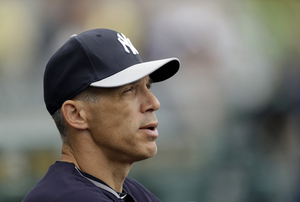 Photo - New York Yankees manager Joe Girardi watches batting practice before a spring exhibition baseball game against the Pittsburgh Pirates in Bradenton, Fla., Monday, March 17, 2014. (AP Photo/Carlos Osorio)