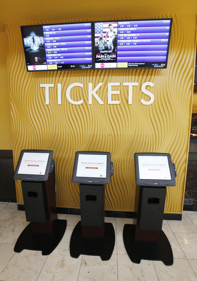 Ticket dispensers allow customers to walk up and purchase tickets in advance in the AMC theater at Penn Square Mall. <strong>PAUL B. SOUTHERLAND - PAUL B. SOUTHERLAND</strong>