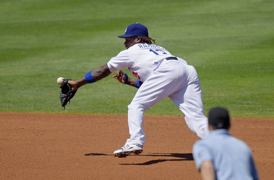 Photo - Los Angeles Dodgers shortstop Hanley Ramirez can't reach a ball hit for a single by New York Mets' David Wright during the third inning of a baseball game, Sunday, Aug. 24, 2014, in Los Angeles. (AP Photo/Mark J. Terrill)