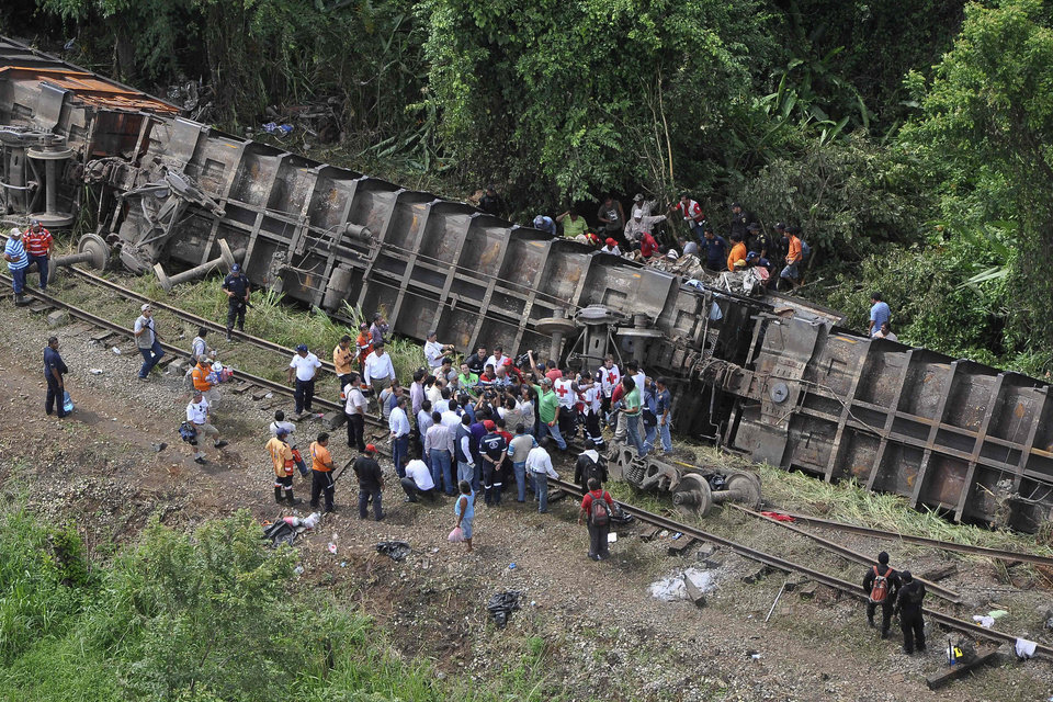 Photo - In this image released by the Tabasco state government press office on Sunday Aug. 25, 2013, rescue workers try to evacuate the injured after a cargo train, known as