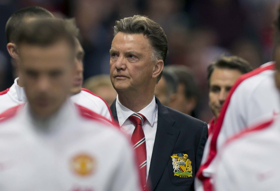 Photo - Manchester United's new manager Louis van Gaal, centre,  takes to the touchline before his team's pre season friendly soccer match against Valencia at Old Trafford Stadium, Manchester, England, Tuesday Aug. 12, 2014. (AP Photo/Jon Super)