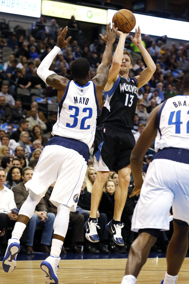 Minnesota Timberwolves guard Luke Ridnour (13) shoots as Dallas Mavericks guard O.J. Mayo (32) defends during the first half of an NBA basketball game, Monday, Jan. 14, 2013, in Dallas. (AP Photo/Sharon Ellman)