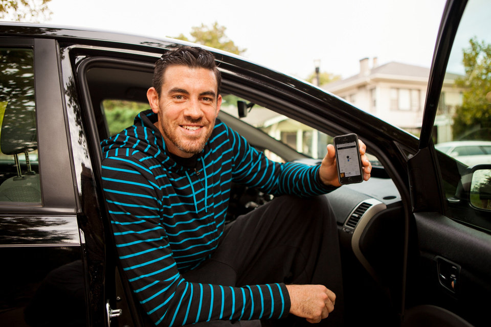 Nick Collison with the Oklahoma City Thunder used the Uber application on his smart phone to call for a ride through the new transportation service that just arrived here last week. PHOTO PROVIDED.