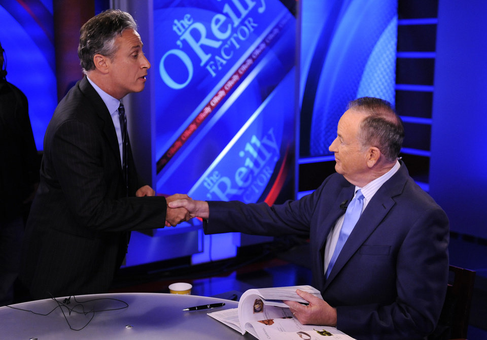 Photo -   FILE - In this Sept. 22, 2010 file photo, Comedy Central's Jon Stewart, left, and Bill O'Reilly tape an interview in New York. Stewart and O'Reilly, a celebrity odd couple with a history of public political feuds, tangle in a sold-out debate in Washington. The so-called