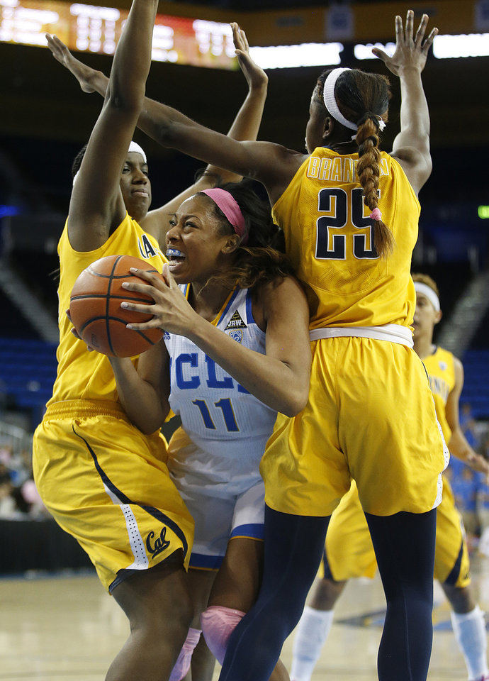 Photo - UCLA forward Atonye Nyingifa, center, is defended by California center Talia Caldwell, left, and forward Gennifer Brandon during the second half of an NCAA women's basketball game in Los Angeles, Friday, Feb. 15, 2013. California won 79-51. (AP Photo/Jae C. Hong)