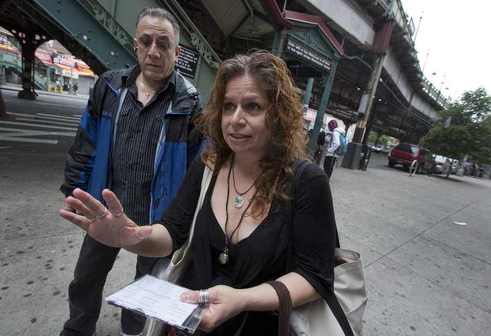 Photo - Folklorist Elena Martinez of City Lore, and her partner Bobby Sanabria, talk about their tours of The Bronx borough of New York,  Wednesday, May 22, 2013.  A company that offered tourist treks to the Bronx