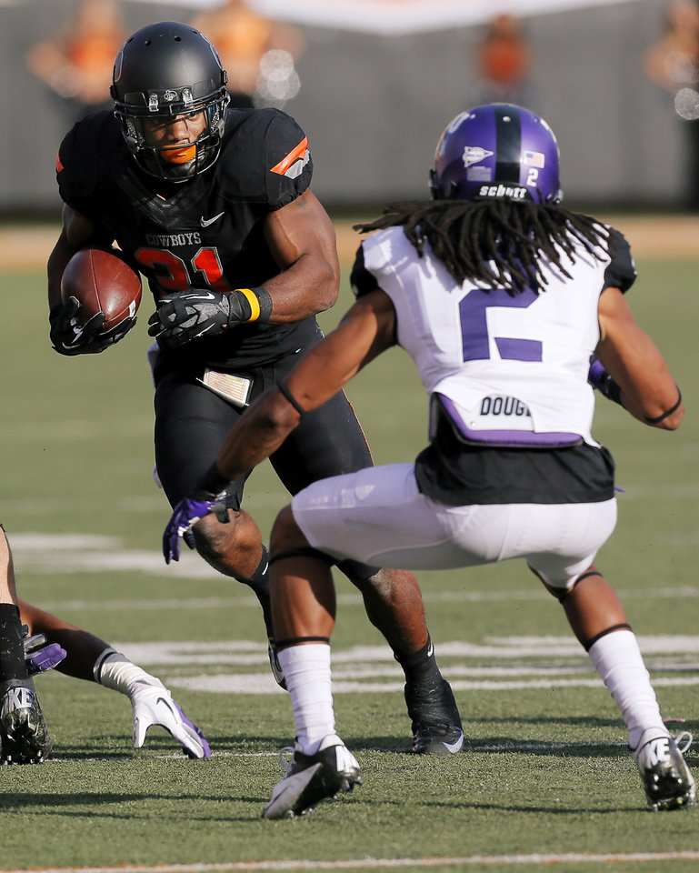 Photo - Oklahoma State's Jeremy Smith (31) tries to get past TCU's Jason Verrett (2) in the third quarter during a college football game between Oklahoma State University (OSU) and Texas Christian University (TCU) at Boone Pickens Stadium in Stillwater, Okla., Saturday, Oct. 27, 2012. OSU won, 36-14. Photo by Nate Billings, The Oklahoman