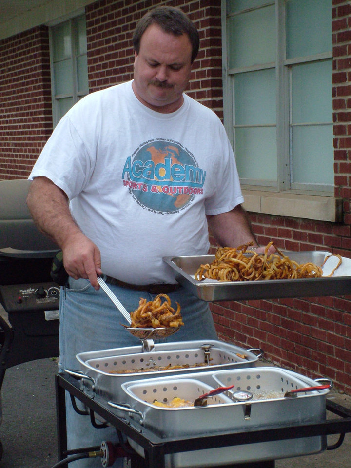 Marty Fry works the fryers at the Harrah United Methodist Church's first annual F3 Fry's Fish Fry on May 7. On the menu were catfish, french fries, fried sweet potatoes, two kinds of coleslaw, hush pupppies and chicken bites. Dessert was homemade apple pies baked by members. Proceeds from the supper will go towards a new sign and parking lot for the church. Fry and his wife, the former Kathy Helm, plan to make the fish fry an annual event.<br/><b>Community Photo By:</b> Lin Archer<br/><b>Submitted By:</b> Lin,