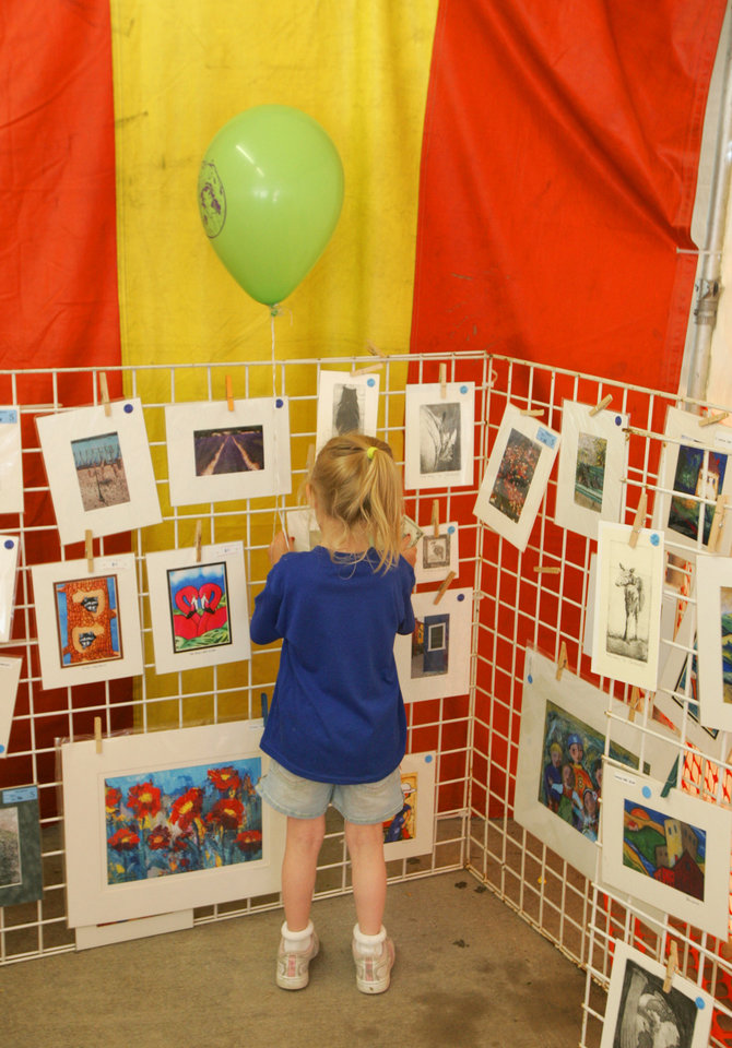 A young art collector shops for prints at Art Mart at the Festival of the Arts in Oklahoma City, Oklahoma April 24, 2009.  Photo by Steve Gooch, The Oklahoman