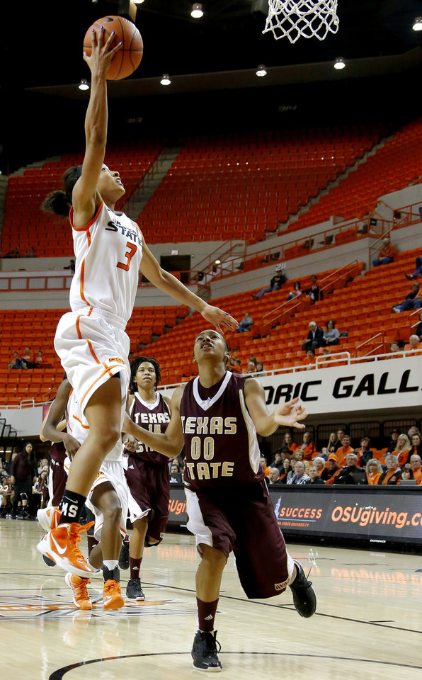 Photo - Oklahoma State's Tiffany Bias (3) goes to the basket past Texas State's Kaylan Martin (00) during a women's college basketball game between Oklahoma State University and Texas State at Gallagher-Iba Arena in Stillwater, Okla., Wednesday, Nov. 28, 2012.  Photo by Bryan Terry, The Oklahoman