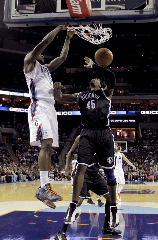 Charlotte Bobcats' Michael Kidd-Gilchrist (14) dunks on Brooklyn Nets' Gerald Wallace (45) during the second half of an NBA basketball game in Charlotte, N.C., Wednesday, March 6, 2013. The Nets won 99-78. (AP Photo/Bob Leverone)