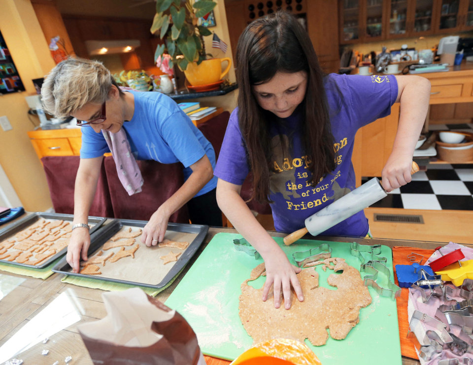 Rachel Rose, at right and her mom, Sara Jane Rose, make dog treats at their Oklahoma City home. Photo by SARAH PHIPPS, The Oklahoman