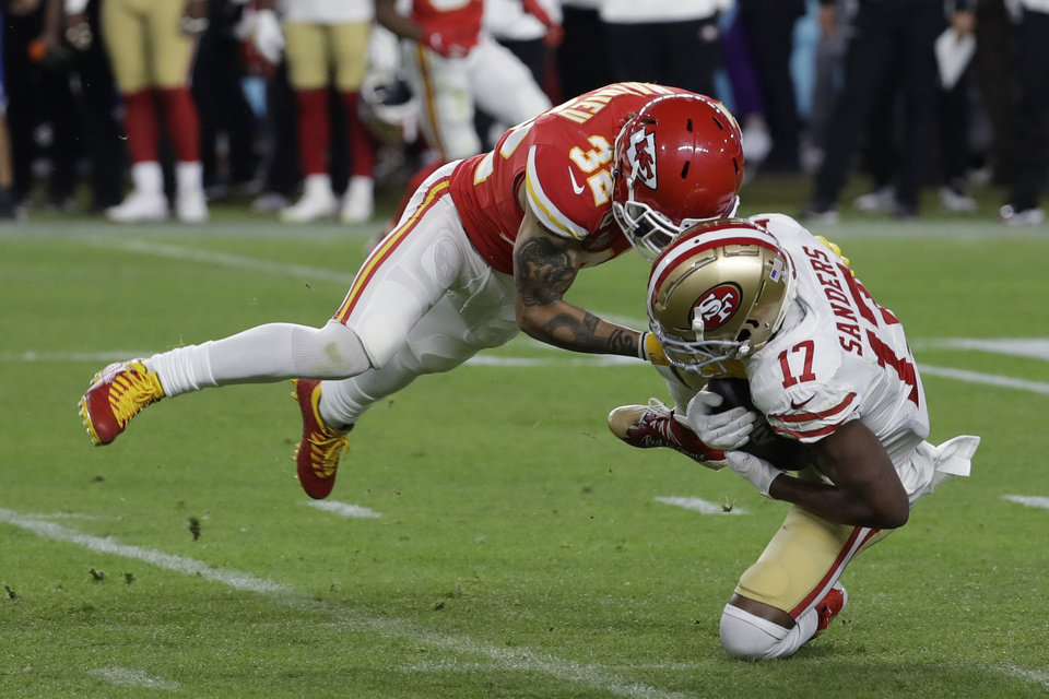 Photo - Kansas City Chiefs' Tyrann Mathieu (32) tackles San Francisco 49ers' Emmanuel Sanders (17) during the second half of the NFL Super Bowl 54 football game Sunday, Feb. 2, 2020, in Miami Gardens, Fla. (AP Photo/Seth Wenig)