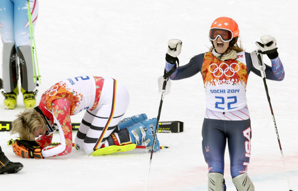 Photo - Germany's Maria Hoefl-Riesch, left, and United States' Julia Mancuso react after winning the gold and bronze medal in the women's supercombined at the Sochi 2014 Winter Olympics, Monday, Feb. 10, 2014, in Krasnaya Polyana, Russia. (AP Photo/Charles Krupa)