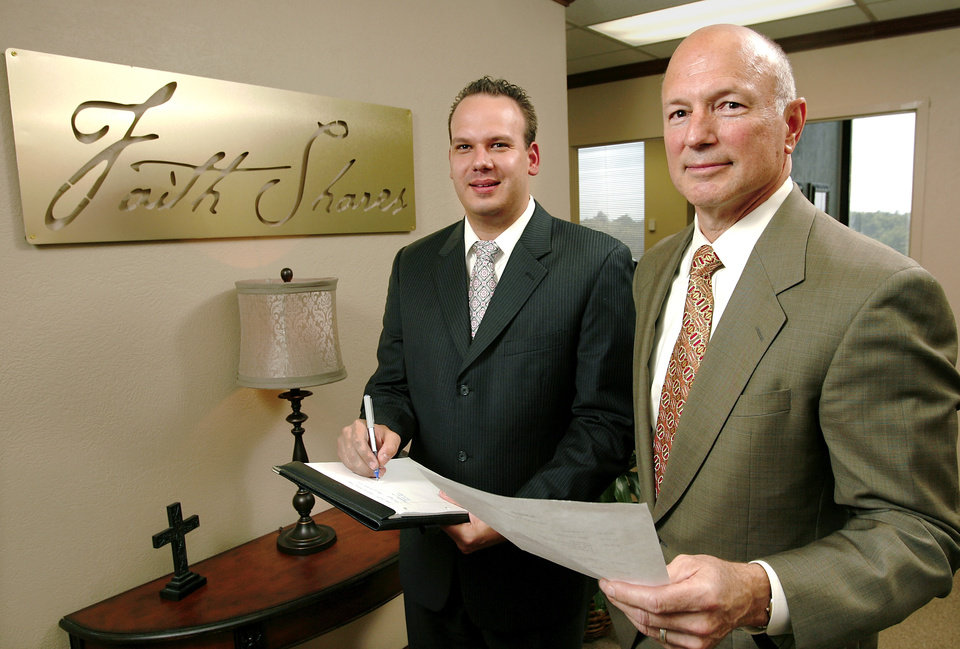Photo - Garrett Stevens, left, and Tom Phillips in the northwest Oklahoma City offices of their company, FaithShares Trust, on  Wednesday, Aug. 12, 2009  Stevens is CEO. Phillips serves as president.  Photo by Jim Beckel, The Oklahoman ORG XMIT: KOD