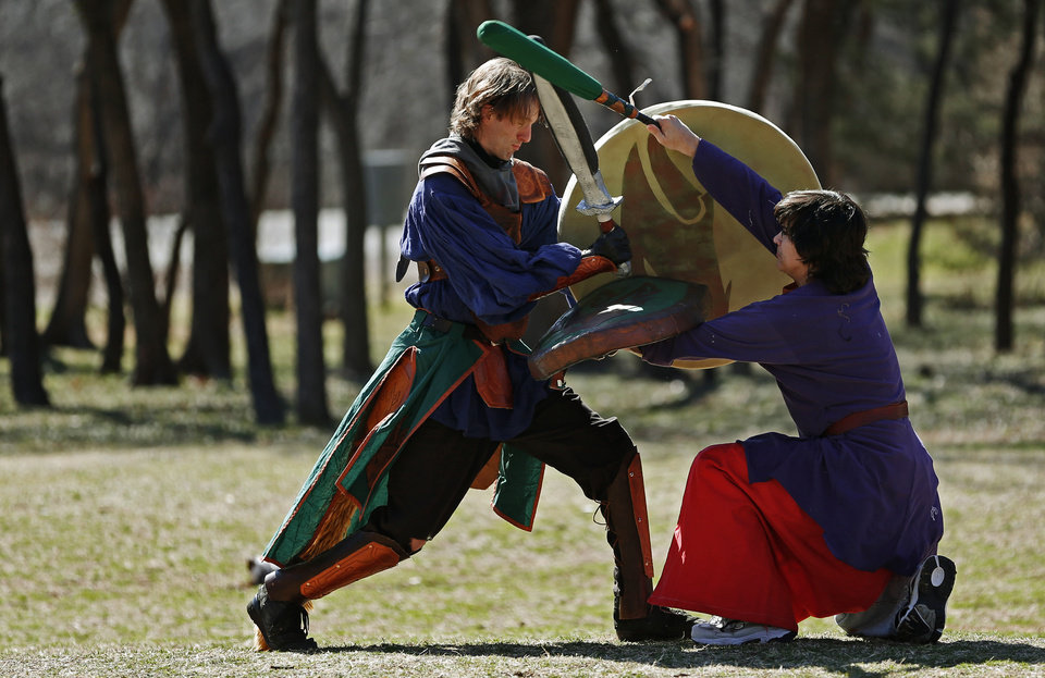 Nathanael Nalley, left, fights Anthony Tennant as they practice Dagorhir at E.C. Hafer Park in Edmond. Photo by Bryan Terry, The Oklahoman