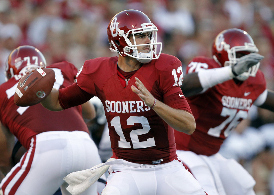 Photo - Oklahoma's Landry Jones (12) looks to throw the ball during the first half of the college football game between the University of Oklahoma Sooners (OU) and Utah State University Aggies (USU) at the Gaylord Family-Oklahoma Memorial Stadium on Saturday, Sept. 4, 2010, in Norman, Okla.   Photo by Chris Landsberger, The Oklahoman