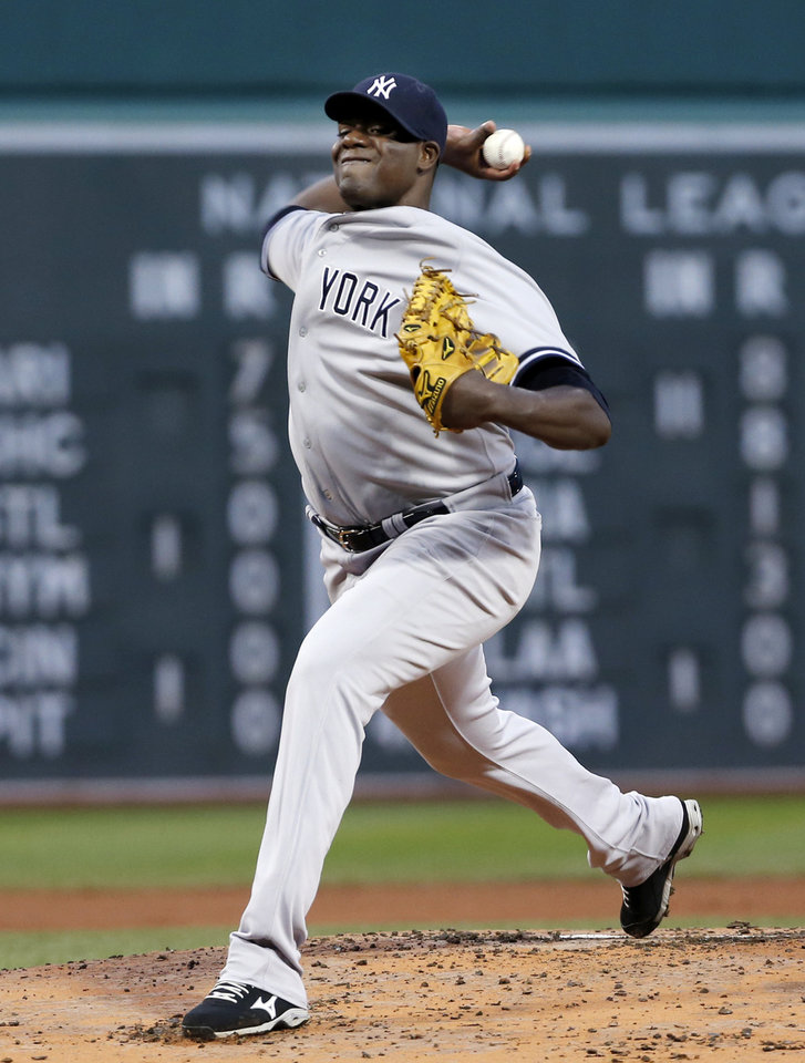 Photo - New York Yankees starting pitcher Michael Pineda delivers to the Boston Red Sox during the first inning of a baseball game at Fenway Park in Boston, Wednesday, April 23, 2014. (AP Photo/Elise Amendola)
