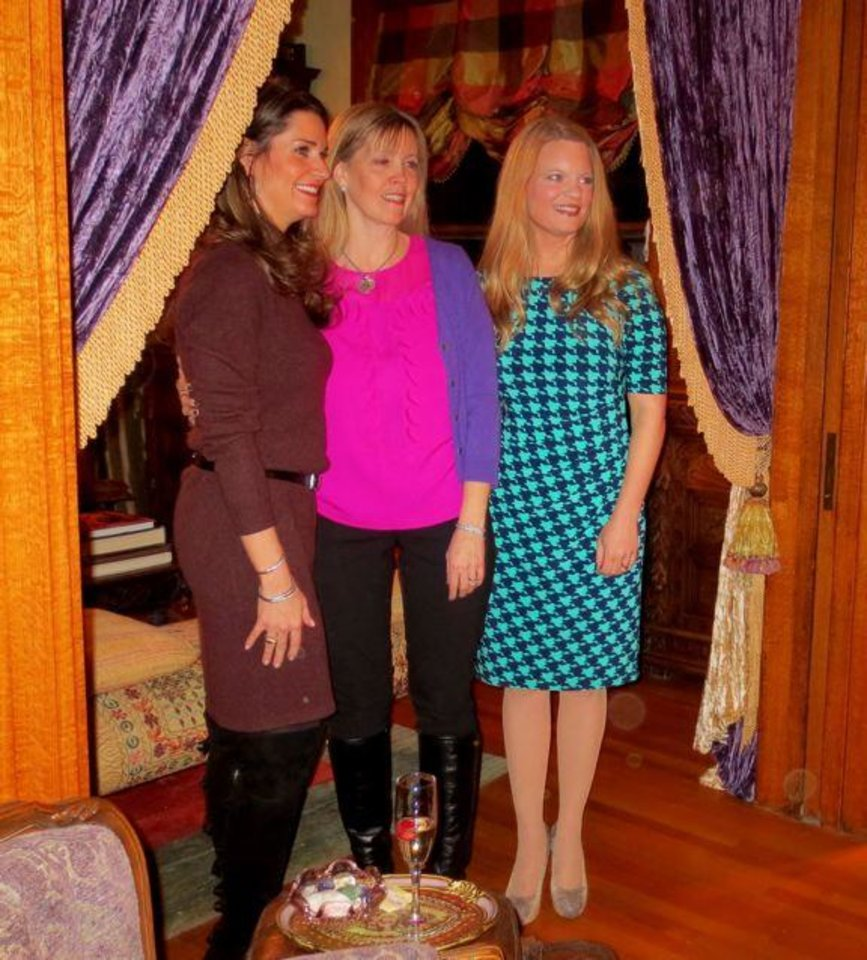 Current Junior League President Cristi Reiger, center, entertained at a reception honoring Kristin Leonard, new President-elect-elect, right, who will take office in 2014, and incoming Board members. The party was in her beautiful home and also honored Kristen Brown, left, who will become President in June. Other new board members are Kim Riley, administrative vice-president; Wendy Mounger, bylaws chairman; Jenifer Stehr, communications vice-president; Sara Sweet, community vice-president; Nicole Blad, finance vice-president; Amy Parrish, fundraising vice-president; Amy McDougall, membership vice-president, and Shannon Gottschalk, nominating chairman. (Photo by Helen Ford Wallace).