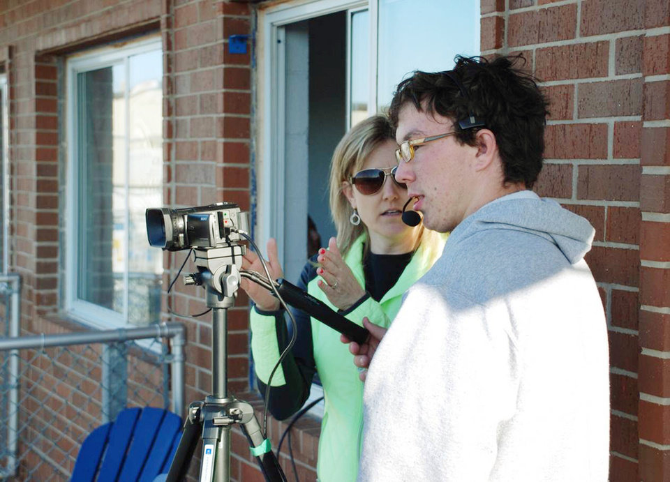 Photo -  Janet Harris, Oklahoma CareerTech Teacher of the Year, works with Deer Creek High School student John Childers on a video shoot. Photo provided   Photo Provided -  Photo Provided