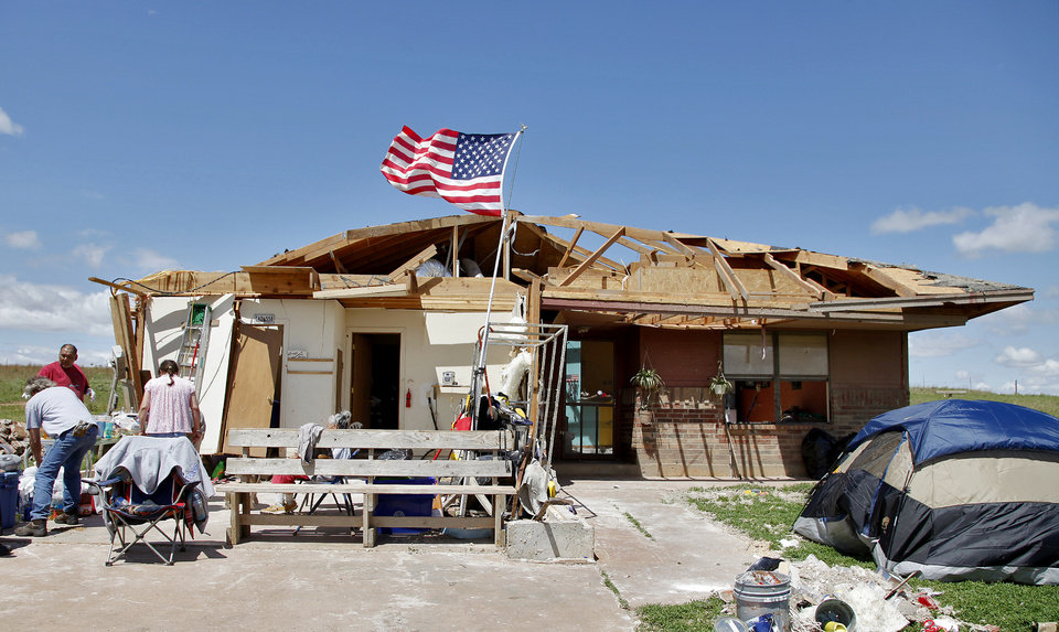 The American flag files outside the home of Robert Todd after being destroyed by Tuesday\'s tornado west of El Reno, Wednesday, May 25, 2011. Photo by Chris Landsberger, The Oklahoman
