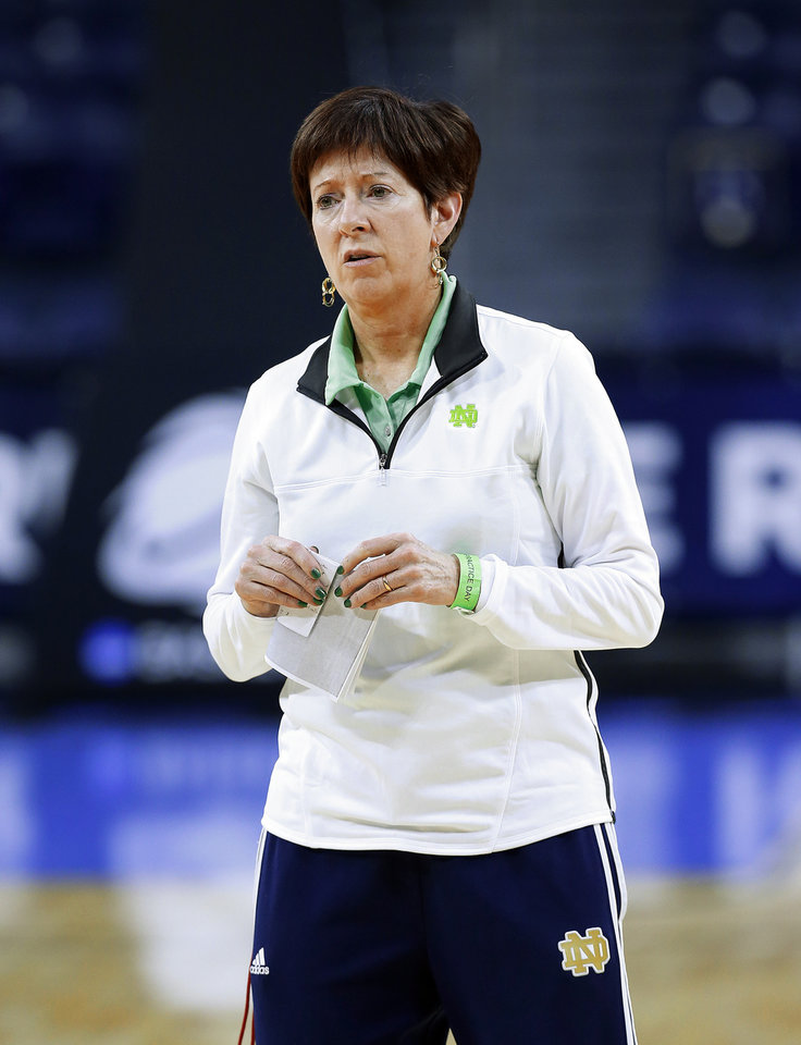 Photo - Notre Dame head coach Muffet McGraw watches during their NCAA women's college basketball tournament practice at the Purcell Pavilion in South Bend, Ind., Friday, March 28, 2014. Notre Dame plays Oklahoma State Saturday. (AP Photo/Paul Sancya)