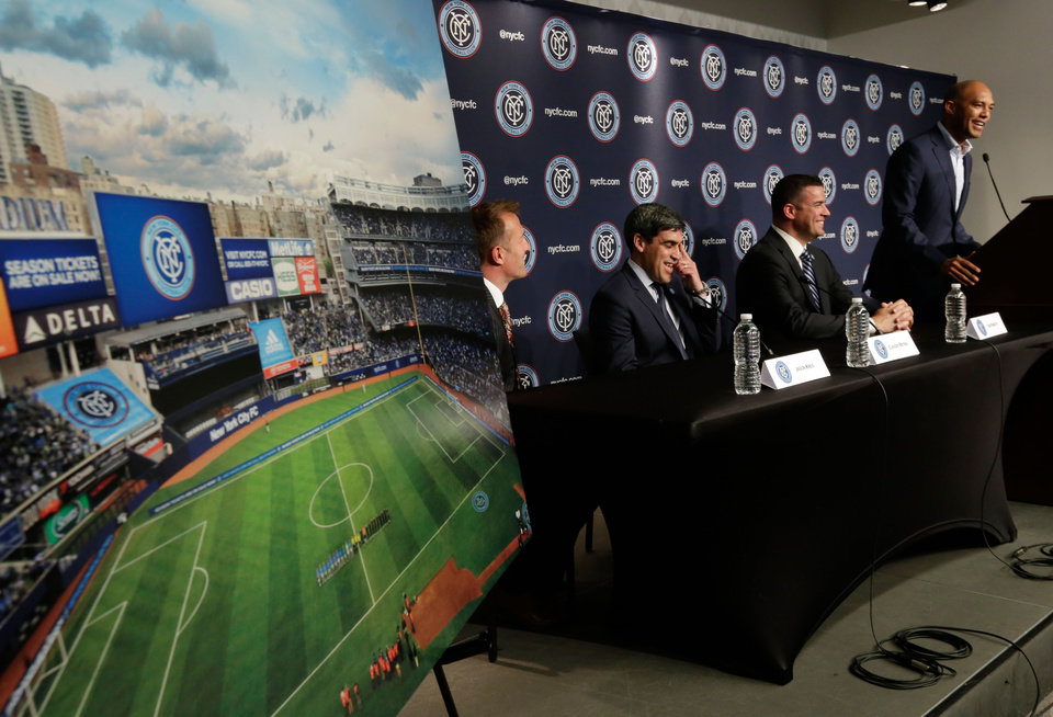 Photo - Retired New York Yankees pitcher Mariano Rivera, right, addresses a New York City Football Club news conference at New York's Yankee Stadium,  Monday, April 21, 2014. Seated, from left, are head coach Jason Kreis, Director of Football Operations Claudio Reyna, and Chief Business Officer Tim Pernetti. The Yankees announced that Yankee Stadium will serve as the Club's first home and begin play on March 2015. (AP Photo/Richard Drew)