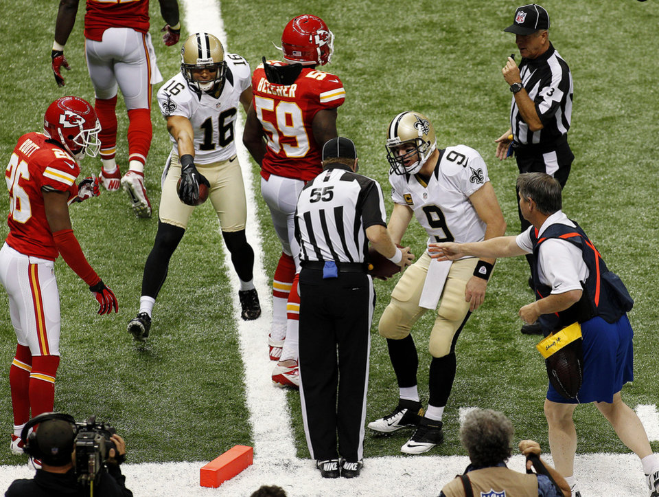 Photo -   New Orleans Saints quarterback Drew Brees (9) challenges the official after wide receiver Lance Moore (16) hit the pylon in the second half of an NFL football game against the Kansas City Chiefs in New Orleans, Sunday, Sept. 23, 2012. After review the pass was ruled incomplete. (AP Photo/Jonathan Bachman)