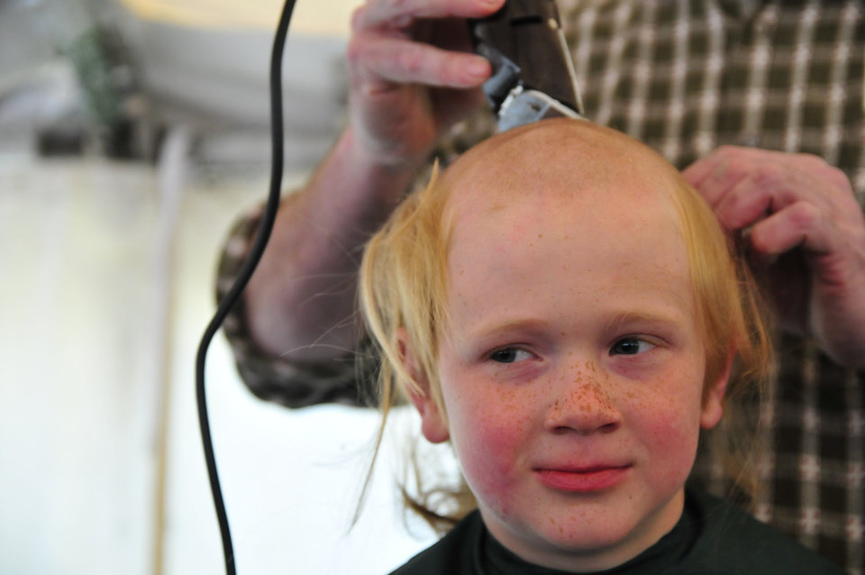 Wyatt Kerr, 8, gets his shaved head during the St. Baldrick\'s charity event at VZD\'s Restaurant and Club in Oklahoma City, Okla. Sunday, March 23, 2013. Photo by Nick Oxford, for The Oklahoman