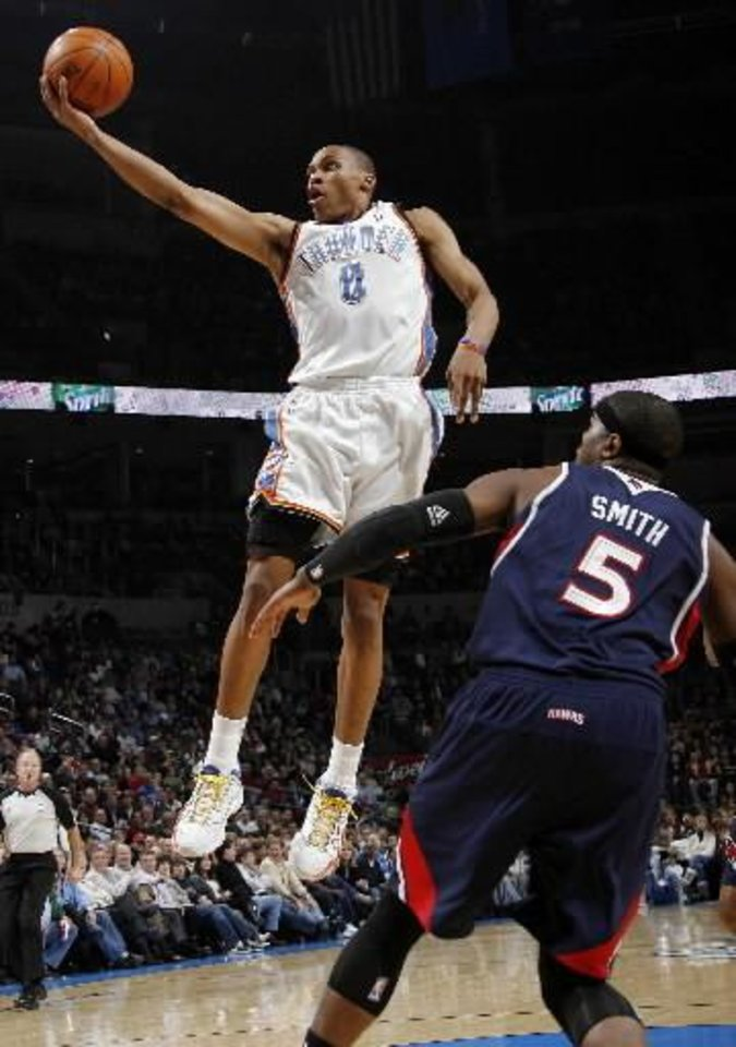 Oklahoma City's Russell  Westbrook (0) shoots over Josh Smith (5) of Atlanta during the NBA basketball game between the Atlanta Hawks and the Oklahoma City Thunder at the Ford Center in Oklahoma City, Tuesday, February 2, 2010. Photo by Nate Billings