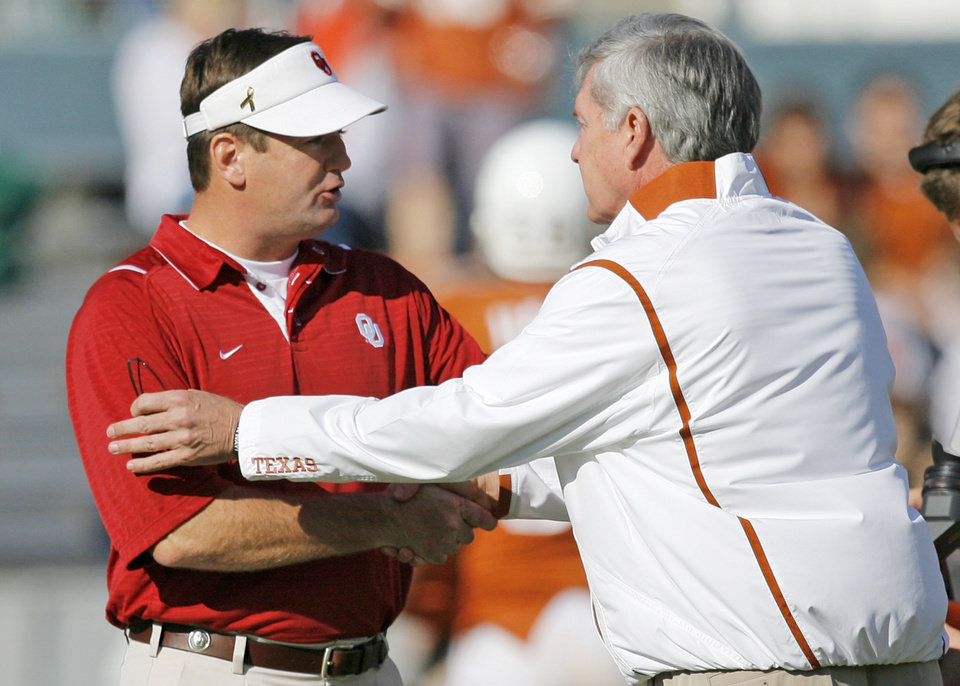 OU head coach Bob Stoops, left, and Texas head coach Mack Brown shake hands before the Red River Rivalry college football game between the University of Oklahoma Sooners (OU) and the University of Texas Longhorns (UT) at the Cotton Bowl in Dallas, Texas, Saturday, Oct. 17, 2009. Photo by Nate Billings, The Oklahoman ORG XMIT: KOD