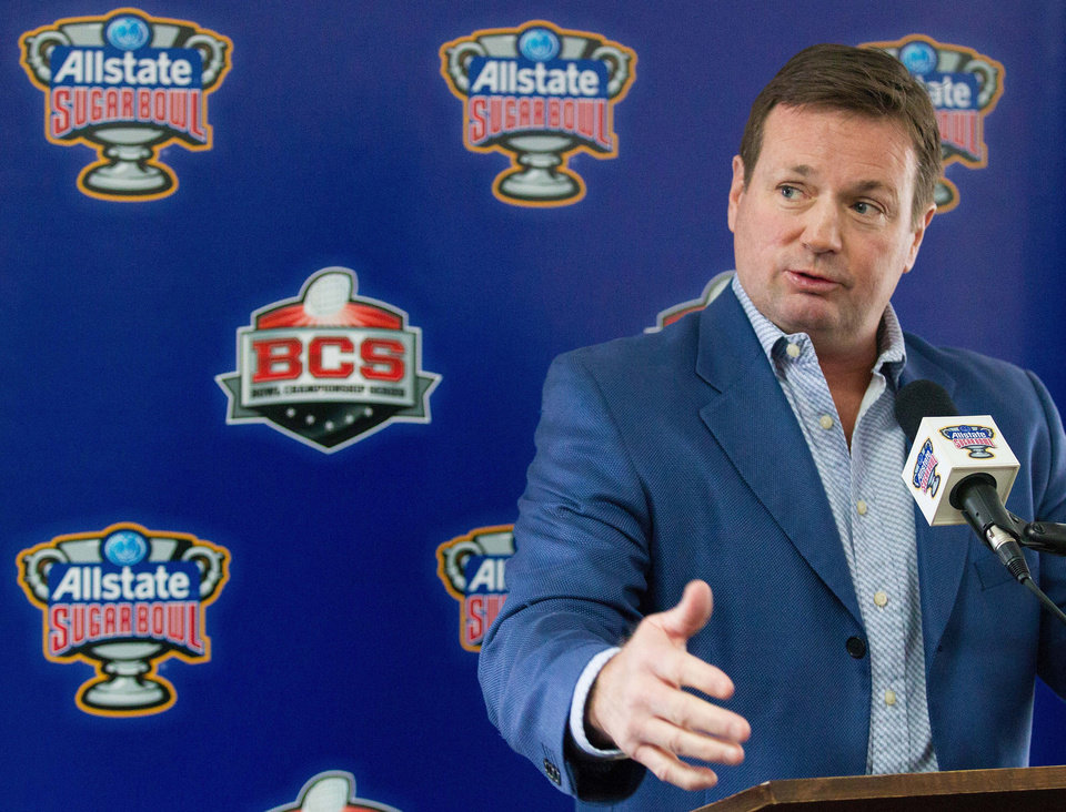 Photo - Oklahoma coach Bob Stoops speaks to reporters after arriving in New Orleans on Friday, Dec. 27, 2013. Oklahoma plays Alabama in the Sugar Bowl NCAA college football game on Thursday, Jan. 2, 2014. (AP Photo/Rusty Costanza)