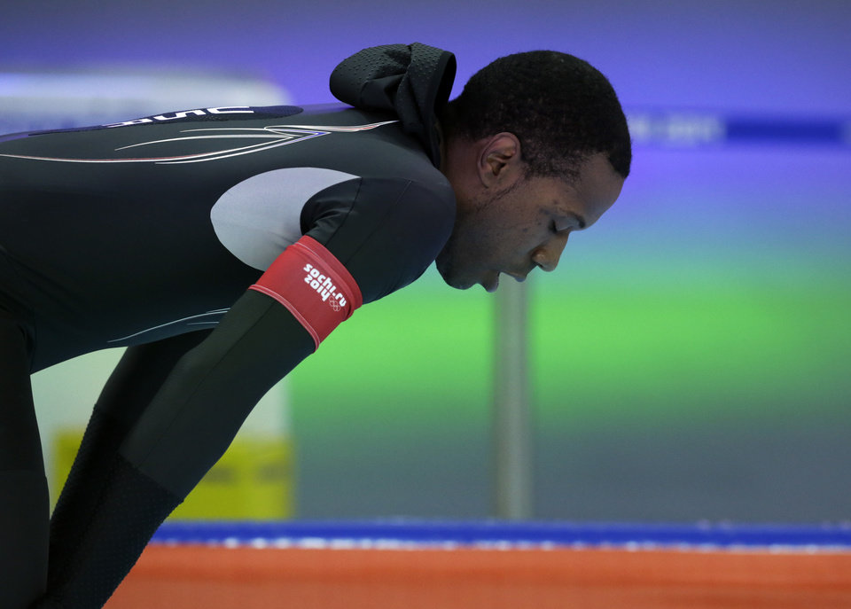 Photo - Shani Davis of the U.S. takes a breather after competing in the men's 1,000-meter speedskating race at the Adler Arena Skating Center during the 2014 Winter Olympics in Sochi, Russia, Wednesday, Feb. 12, 2014. (AP Photo/Matt Dunham)