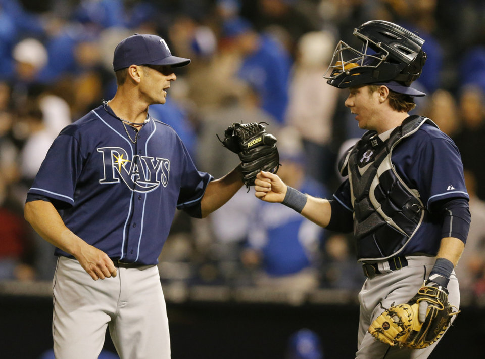 Photo - Tampa Bay Rays relief pitcher Grant Balfour, left, is congratulated by catcher Ryan Hanigan, right, following a baseball game against the Kansas City Royals at Kauffman Stadium in Kansas City, Mo., Tuesday, April 8, 2014. The Tampa Bay Rays defeated the Royals 1-0. (AP Photo/Orlin Wagner)