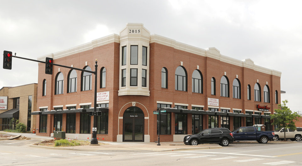 Photo -  Campbell Corner, at Broadway and Campbell, is almost complete and starting to lease space for businesses in downtown Edmond. [PHOTO BY DOUG HOKE, THE OKLAHOMAN]
