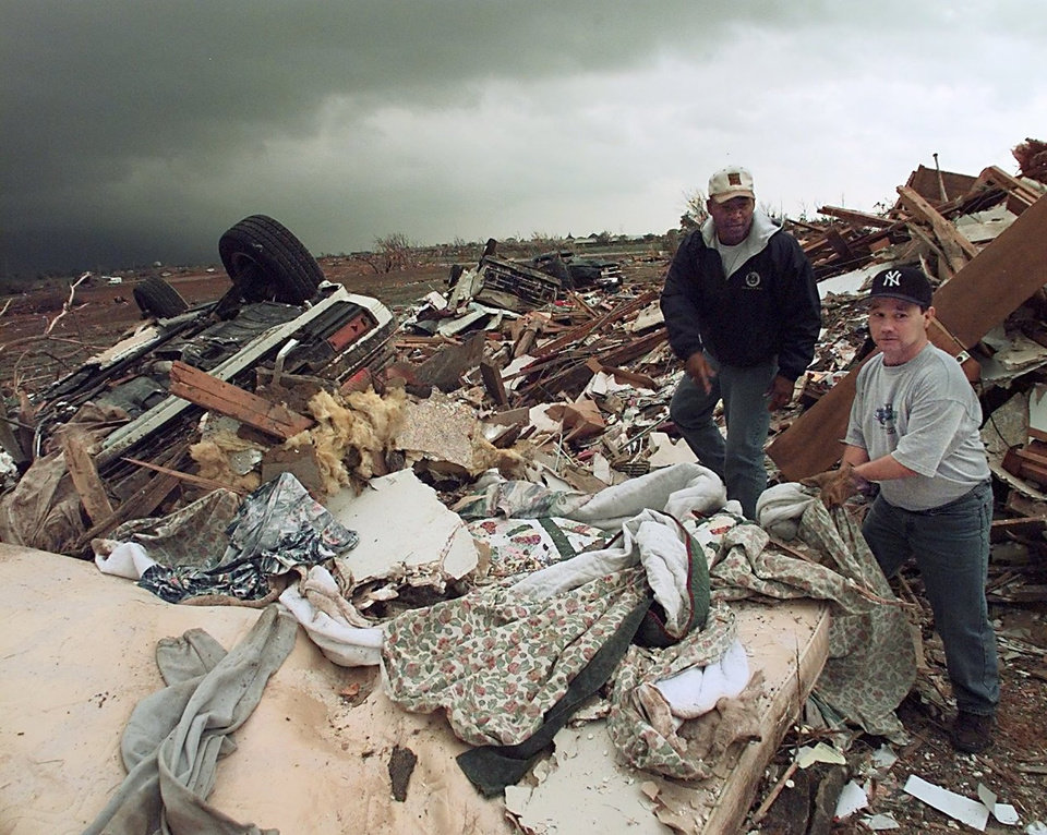 MAY 3, 1999 TORNADO: TORNADO DAMAGE, VICTIMS: L TO R. MIKE NEWSOM AND BILL PAIGE LOOK FOR ANYTHING SALVAGABLE AFTER A TORNADO WHIPPED THREW THEIR NEIGHBORHOOD OFF OF 12TH STREET AND SANTA FE IN MOORE, OK.
