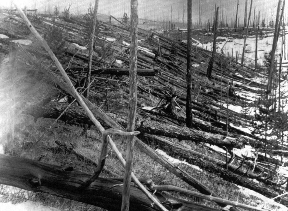 Photo - FILE - In this 1953 file photo, trees lie strewn across the Siberian countryside 45 years after a meteorite struck the Earth near Tunguska, Russia. The 1908 explosion is generally estimated to have been about 10 megatons; it leveled some 80 million trees for miles near the impact site. The meteor that streaked across the Russian sky Friday, Feb. 15, 2013, is estimated to be about 10 tons. It exploded with the power of an atomic bomb over the Ural Mountains, about 5,000 kilometers (3,000 miles) west of Tunguska. (AP Photo, File)
