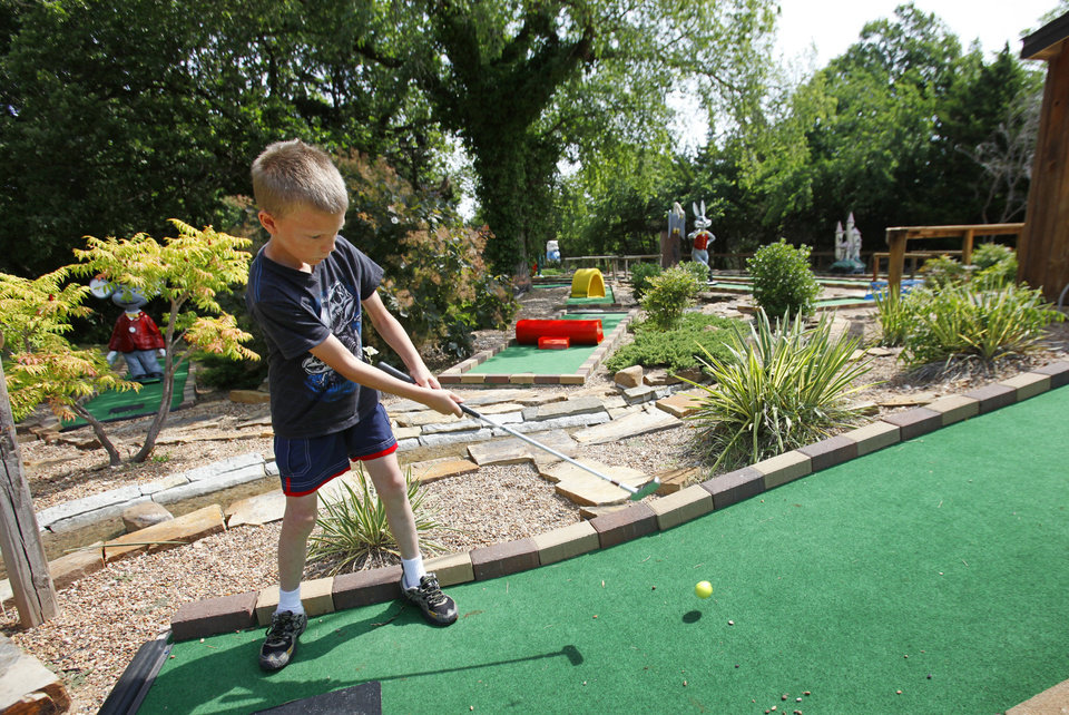 Photo - Brent Willams, 8, from Del City, plays around of miniature golf at Roman Nose State Park, Tuesday , May 22, 2012. Photo By David McDaniel/The Oklahoman