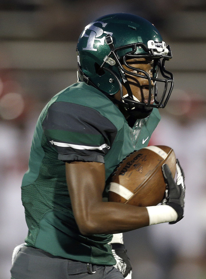 Edmond Santa Fe's Malcolm Dade runs up field for a touchdown during the high school football game between Edmond Santa Fe and Mustang at Wantland Stadium in Edmond, Okla.,   Thursday, Oct. 3, 2013. Photo by Sarah Phipps, The Oklahoman