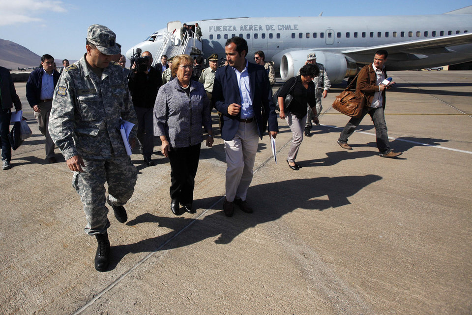 Photo - Chile's President Michelle Bachelet arrives at the airport in Iquique, Chile, Wednesday, April 2, 2014. Chilean authorities discovered surprisingly light damage Wednesday from a magnitude-8.2 quake that struck in the Pacific Ocean, Tuesday evening, near the mining port of Iquique, Six deaths have been reported. Bachelet declared a state of emergency and was flown to Iquique, a northern coastal city of nearly 200,000 people, to review the damage. (AP Photo/ Luis Hidalgo, Pool)