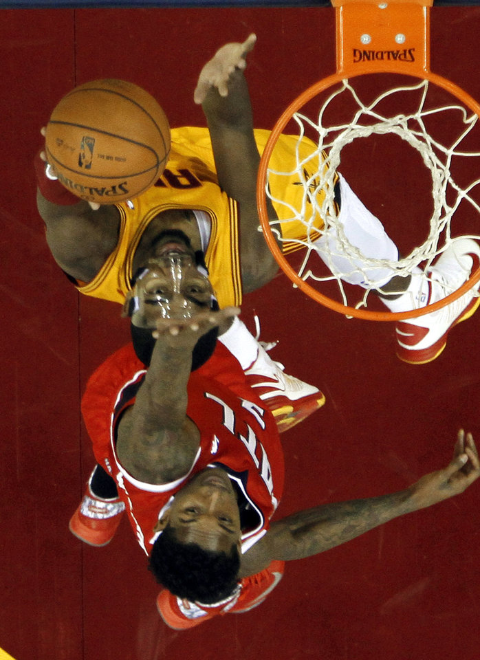 Cleveland Cavaliers\' Tristan Thompson, top, shoots against Atlanta Hawks\' Josh Smith in the first quarter of an NBA basketball game, Friday, Dec. 28, 2012, in Cleveland. (AP Photo/Mark Duncan)